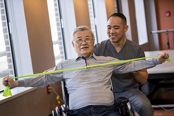 Korean man with resistance bands