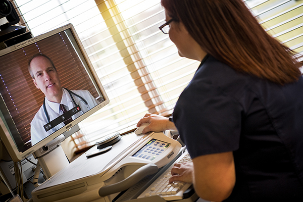Telehealth nurse on computer